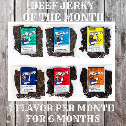 Six flavors of jerky on a wooden background with the words Beef Jerky of the MOnth 1 Flavor Per Month for 6 months