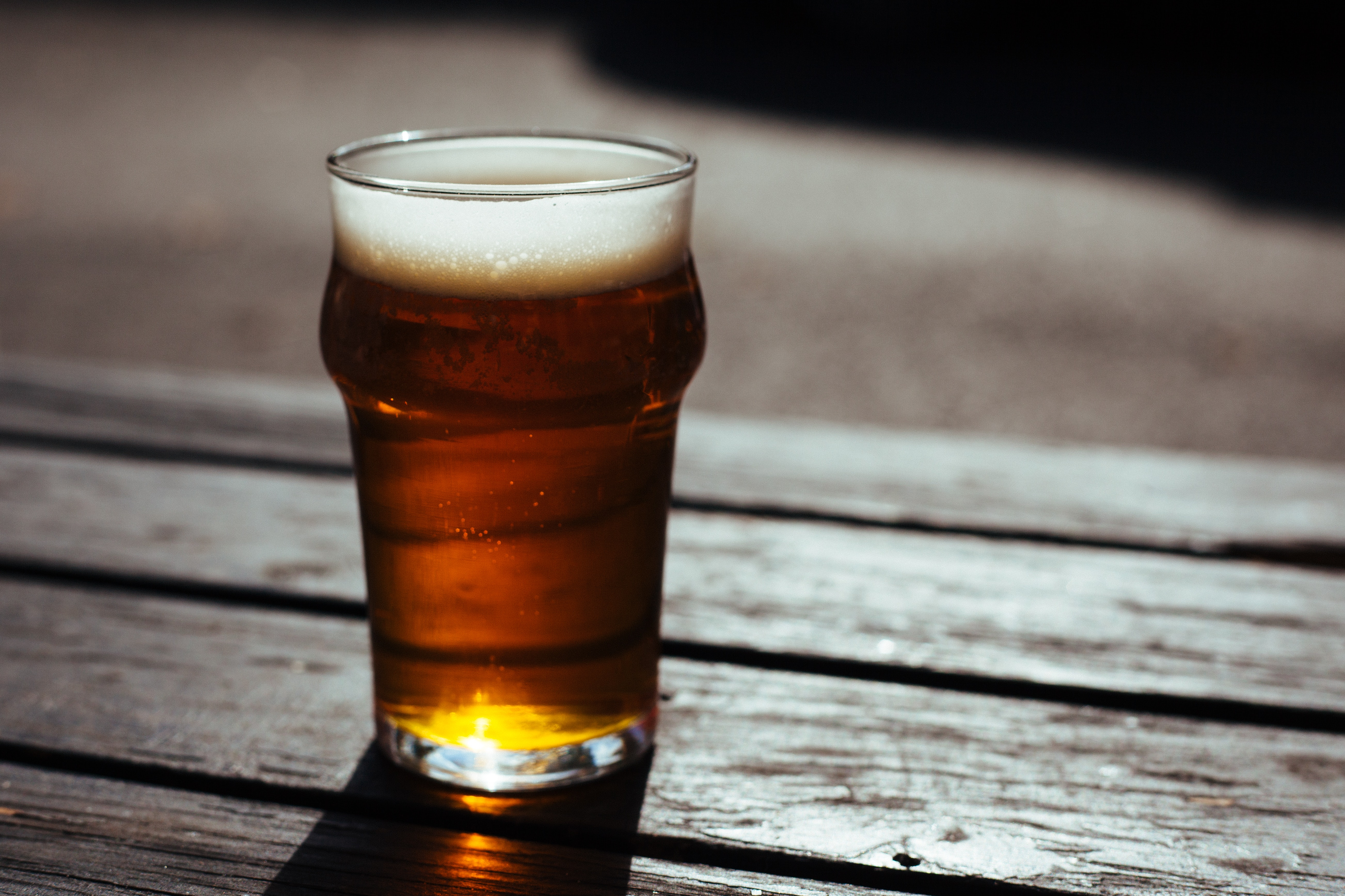 Glass of beer on table