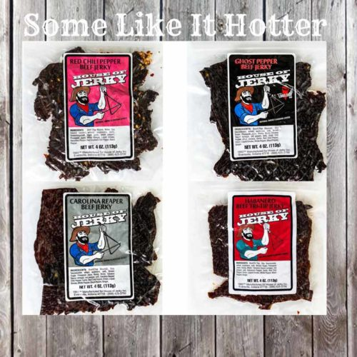 4 Jerky Bags on a wooden background with the words Some Like It Hotter at the top