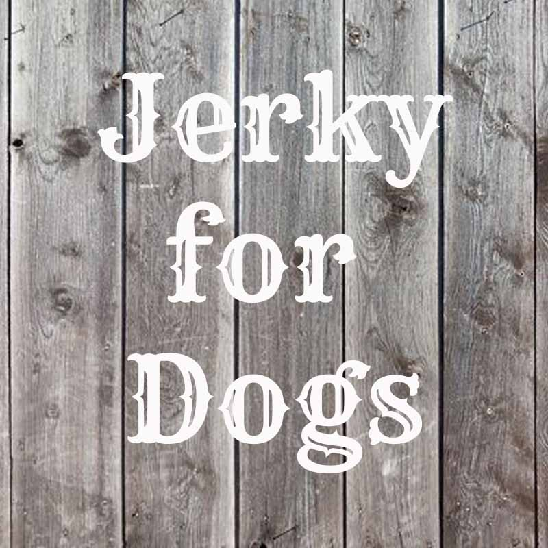 the word jerky for dogs on wood background