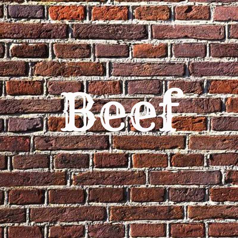 the word beef on a brick background