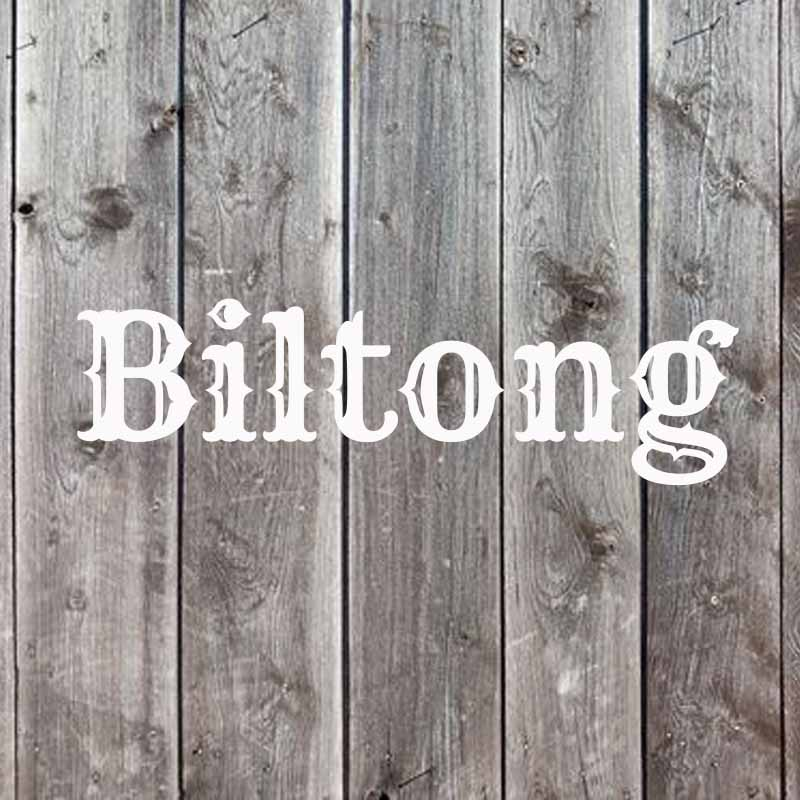 the word biltong on a wood background