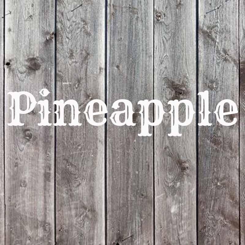 the wordpineapple on wood background